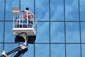 Cleaning windows with Elevated Work Platforms